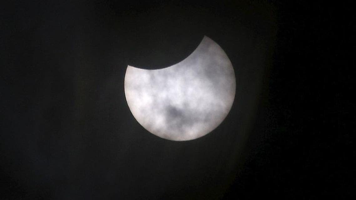 World watches solar eclipse in awe