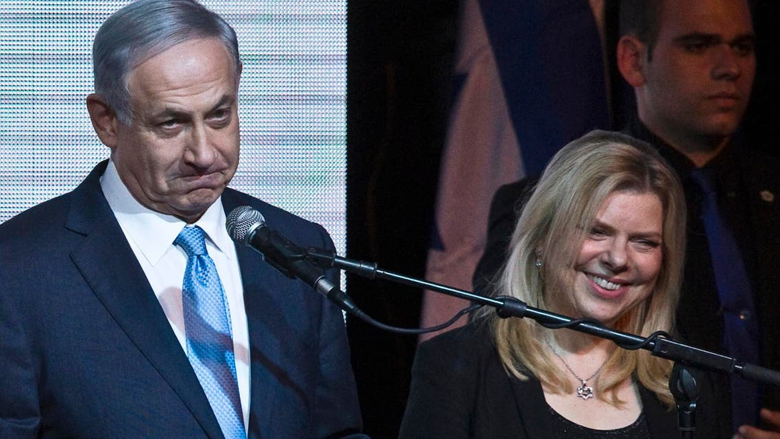 Israeli Prime Minister Benjamin Netanyahu stands next to his wife Sara as he delivers a speech to supporters at party headquarters in Tel Aviv March 18, 2015. (Reuters)