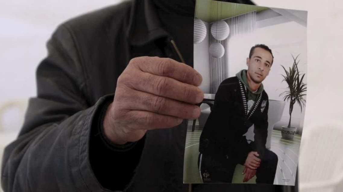 The cousin of Yassine al-Abidi, who gunned down 20 foreign tourists at Tunisia's Bardo museum, shows a photo of Yassine during an interview with Reuters in Tunis March 20, 2015. (Reuters)