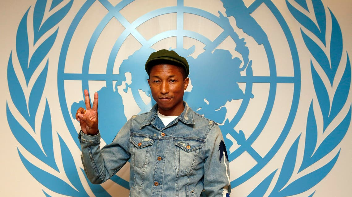Musician Pharrell Williams (R) and Philippe Cousteau during the International Day of Happiness. (AP)