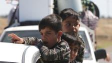 Iraqi Sunnis accuse Shiite paramilitaries of burning homes outside Tikrit