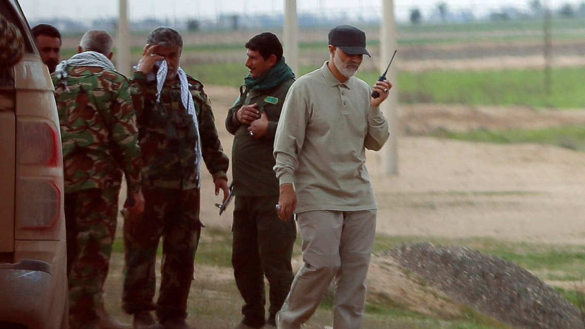 Iranian Revolutionary Guard Commander Qassem Soleimani uses a walkie-talkie at the frontline during offensive operations against ISIS militants in Salahuddin province March 8, 2015. (Reuters)
