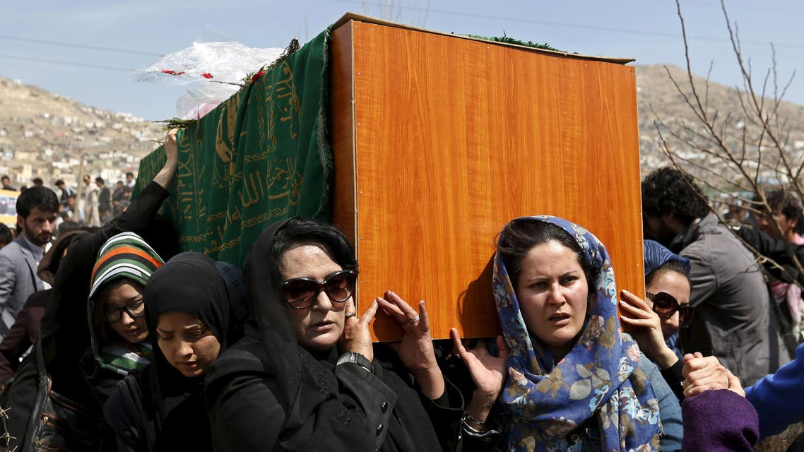 Afghan women's rights activists carry the coffin of Farkhunda, an Afghan woman who was beaten to death and set alight on fire on Thursday, during her funeral ceremony in Kabul March 22, 2015. (Reuters)
