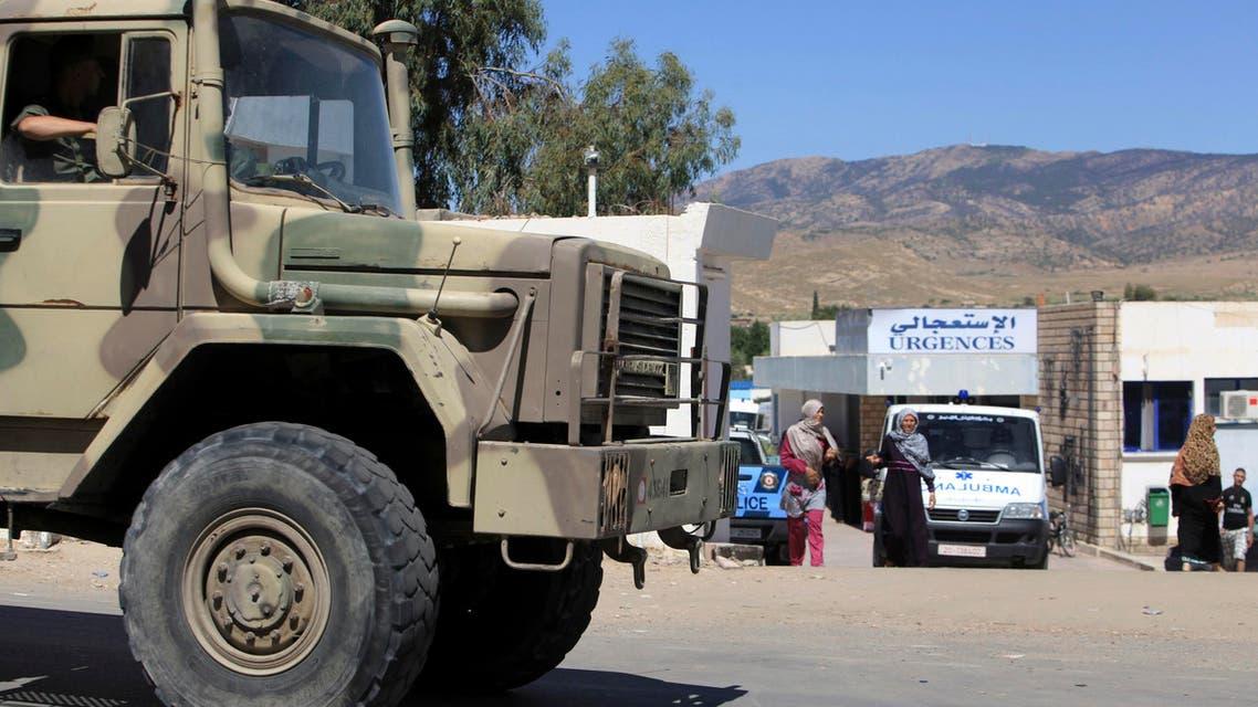 A military truck parks outside the hospital of Kasserine, near the Algerian border, Thursday, July 17, 2014. AP