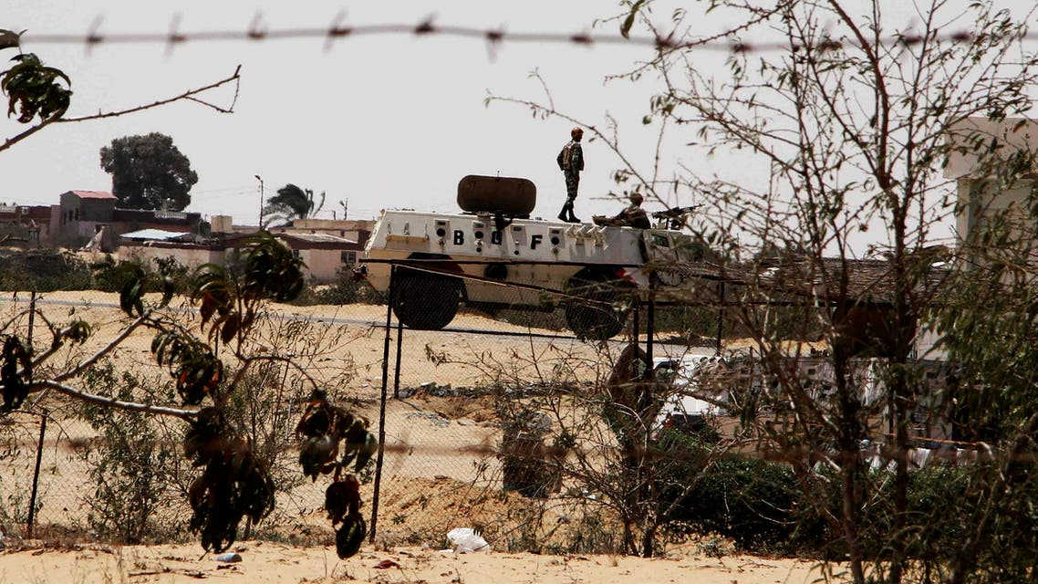 In this Monday, Aug. 6, 2012 file photo, Egyptian border guards patrol near the border with Israel in Rafah, Egypt. AP