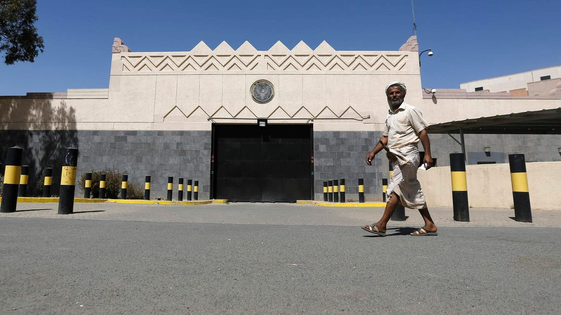 A man walks past the U.S. embassy in Sanaa, after the road in front of it was opened by police March 4, 2015. (Reuters)
