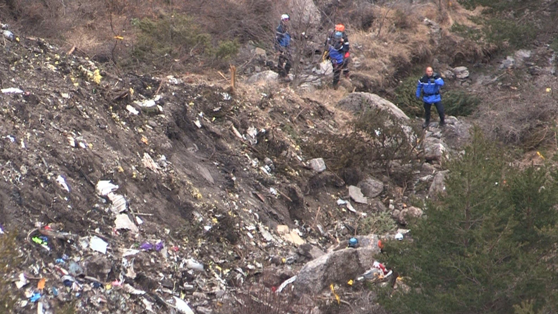 A screengrab taken from an AFP TV video on March 24, 2015 shows search and rescue personnel near scattered debris. (AFP)