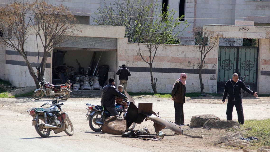 People inspect a site targeted by what activists said was a poison gas attack in the village of Sarmin in Idlib province March 17, 2015. (Reuters)