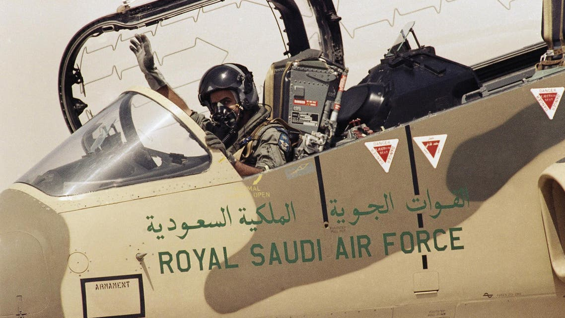 A pilot of the Royal Saudi Air Force waves to ground personnel to take off in his American made F-15 Eagle Fighter Jet on Wednesday, August 15, 1990 at an Air Base in Saudi Arabia. (AP)