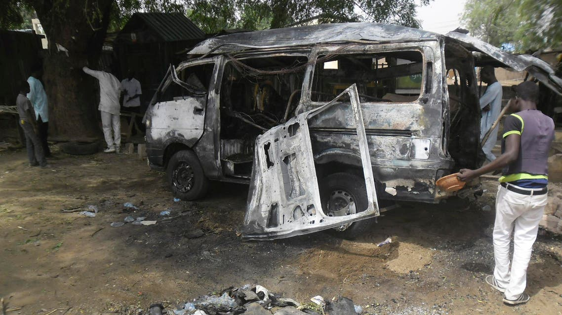 Men inspect a bus following an explosion on the street in Potiskum, Nigeria. Tuesday, Feb. 24, 2015 . A man forced his way onto a bus at a crowded bus station and detonated explosives that killed 12 people and injured 20 in northeast Nigeria, according to the bus driver and hospital records. (File Photo:AP)