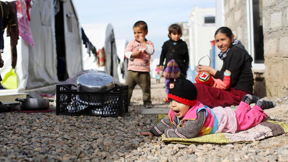 Yazidi refugees children are seen in front of their tent at refugee camp in the outskirts of Duhok, February 27, 2015. (Reuters)