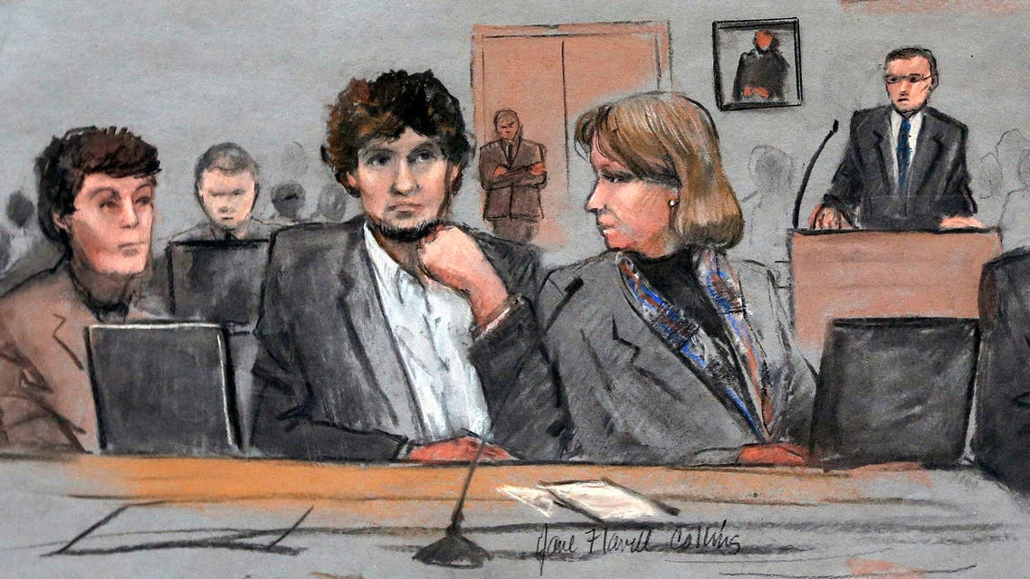 In this courtroom sketch, Dzhokhar Tsarnaev, center, is depicted between defense attorneys Miriam Conrad, left, and Judy Clarke, right, during his federal death penalty trial, March 5, 2015, in Boston. (File Photo: AP)