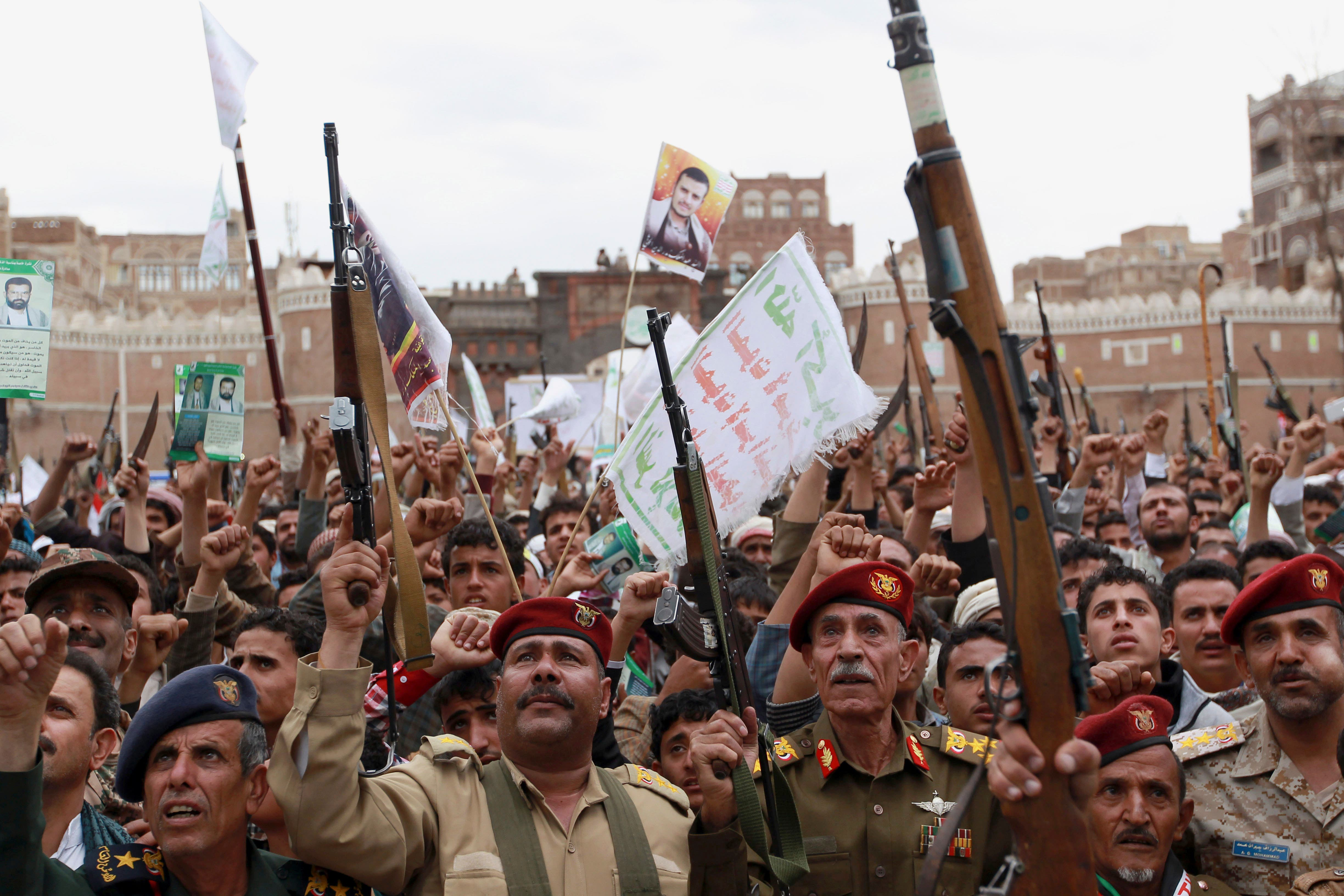 Houthis hold up their weapons to protest against Saudi-led airstrikes, during a rally in Sanaa, Yemen, Thursday, March 26, 2015. (AP)