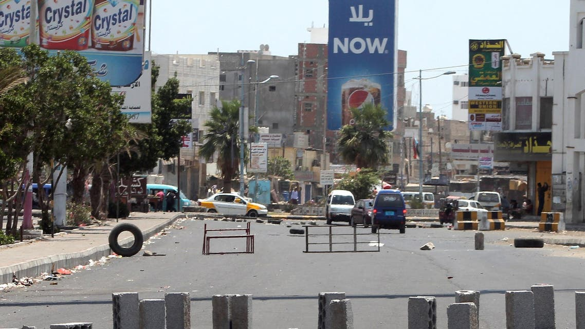 Bricks and obstacles are placed in the middle of the street to create a road block in the northern entrance of the southern Yemeni city of Aden on March 27, 2015.  (AFP)