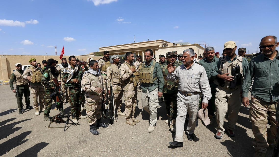 Head of the Badr Organisation and Shi'ite paramilitary commander Hadi al-Amiri (3nd R) Inspects Hashid Shaabi (Popular Mobilisation) allied with Iraqi forces against ISIS in a town on the outskirts of Tikrit March 26, 2014. (Reuters)