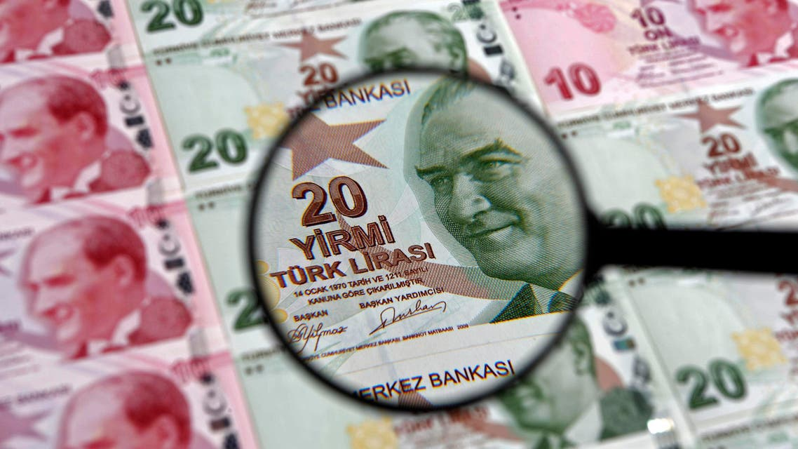 A 20 Turkish Lira banknote is seen through a magnifying lens in this file photo illustration taken in Istanbul, January 28, 2014. (Reuters)