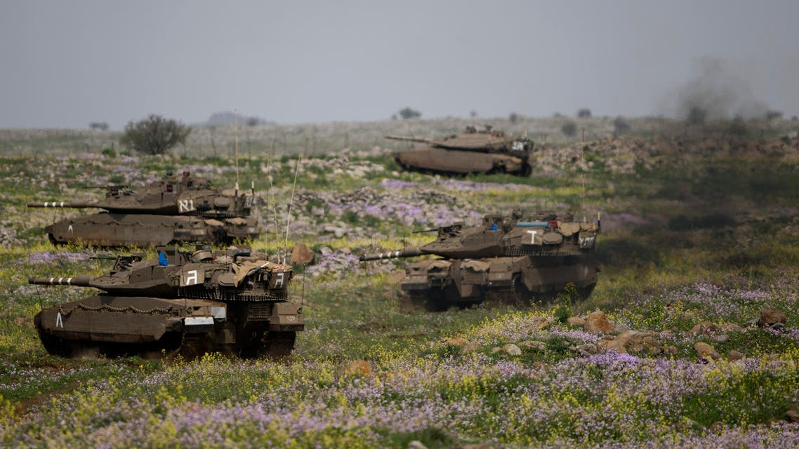 Israeli tanks take positions during training in the Israeli-controlled Golan Heights, near the border with Syria Monday, March 9, 2015. AP