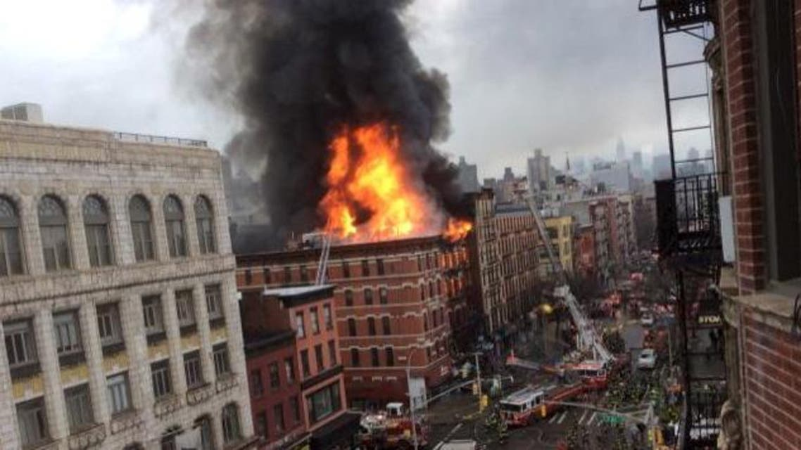 Fire shoots from the roof of a building after it collapsed and burst into flames in New York City's East Village as seen in this picture taken by Scott Westerfeld March 26, 2015. (Reuters)