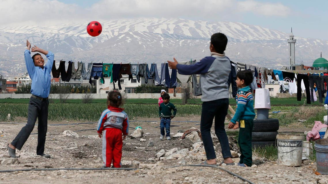 Syrian children play with a ball at a makeshift settlement for Syrian refugees in Bar Elias, in the Bekaa valley, March 15, 2015. (Reuters)