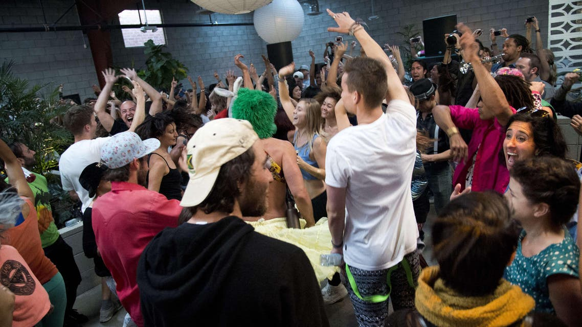 People move on the dance floor at the Daybreaker LA morning dance party, at the Springs in downtown Los Angeles Arts District on March 25, 2015. (AFP)