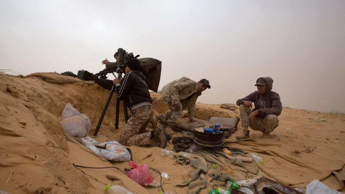 In this Saturday, Feb. 21, 2015 photo, Libyan soldiers aim their weapons during clashes with militants on the frontline in Al Ajaylat, 120 kilometers (75 miles) west of Tripoli. (AP)