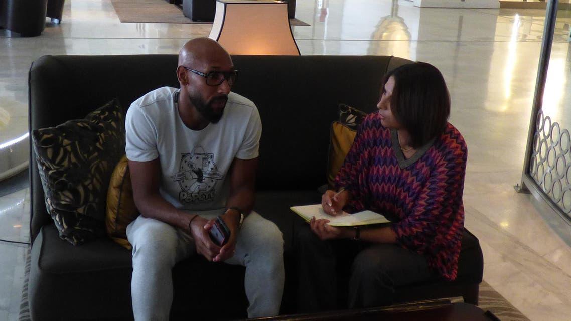 Footballer Nicolas Anelka interviewed by journalist Nabila Ramdani at the Aurassi Hotel in Algiers. (Al Arabiya)