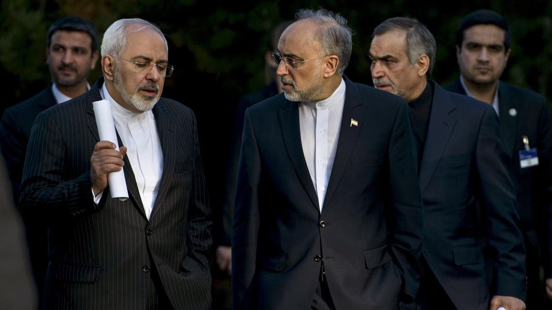 Iranian Foreign Minister Javad Zarif (L) talks with Head of the Iranian Atomic Energy Organization Ali Akbar Salehi after an afternoon meeting with U.S. Secretary of State John Kerry and U.S. officials at the Beau Rivage Palace Hotel in Lausanne March 27, 2015. (AP)