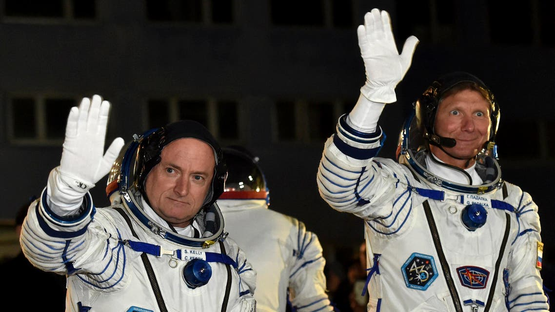 U.S. astronaut Scott Kelly, left, and Russian cosmonaut Gennady Padalka, crew members of the mission to the International Space Station, ISS, wave prior to the launch of Soyuz-FG rocket at the Russian-leased Baikonur cosmodrome, Kazakhstan, Friday, March 27, 2015. AP
