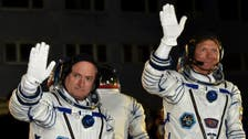 Astronauts board space station for one-year mission