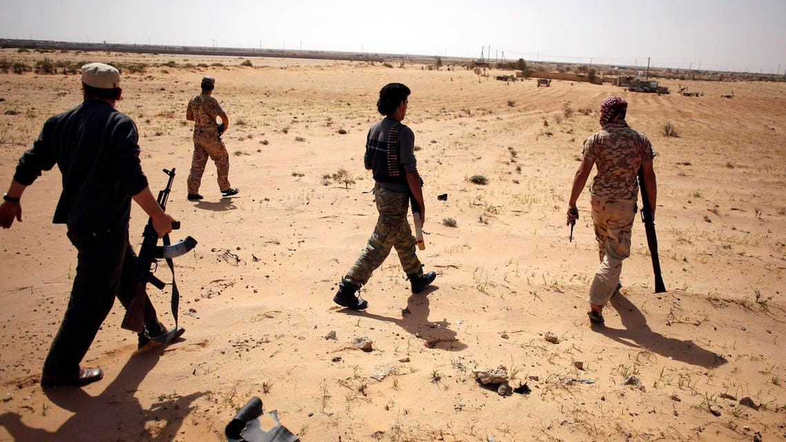 Libya Dawn fighters search for Islamic State militants during a patrol near Sirte March 17, 2015. (Reuters)