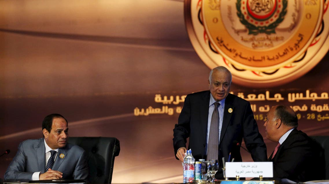 Egyptian President Abdel Fattah al-Sisi (L) looks on to Egypt's Foreign Minister Sameh Shoukry (R) and Arab League Secretary-General Nabil Elaraby (C). (Reuters)