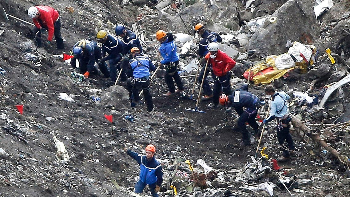Rescue workers work on debris of the Germanwings jet at the crash site near Seyne-les-Alpes, France, Thursday, March 26, 2015.  (AP)