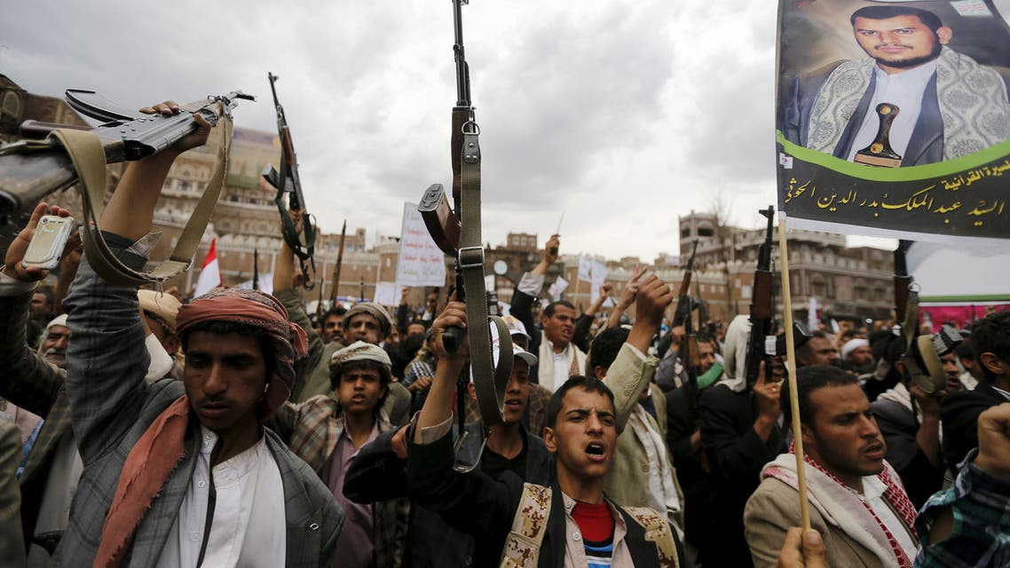 Shi'ite Muslim rebels hold up their weapons during a rally against air strikes in Sanaa March 26, 2015. (Reuters)