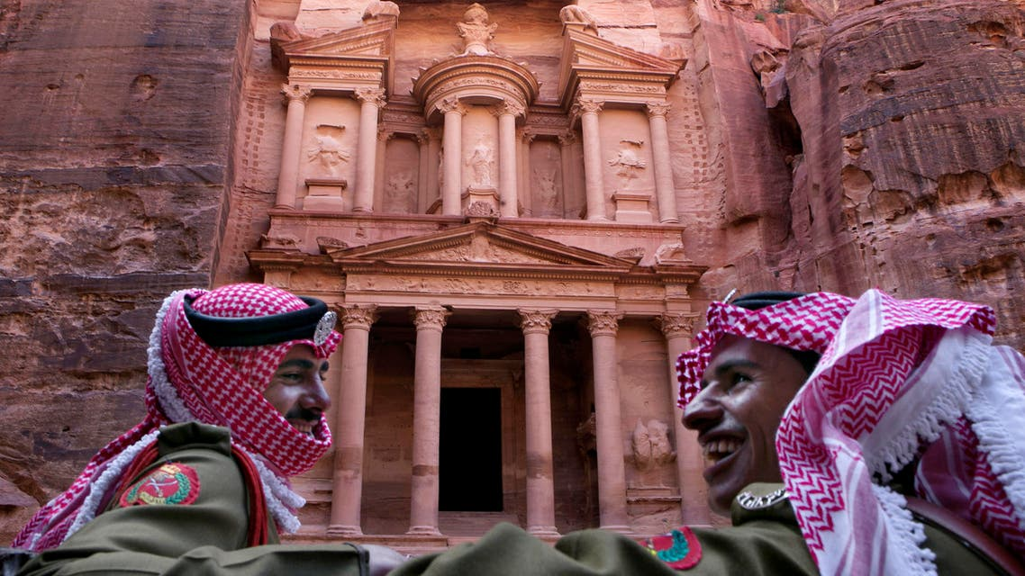 In this Tuesday, March 24, 2015 photo, Jordanian royal desert forces stand guard in front of Al Khazneh, Arabic for the Treasury, the most dramatic of many facades carved into the mountains. (AP)