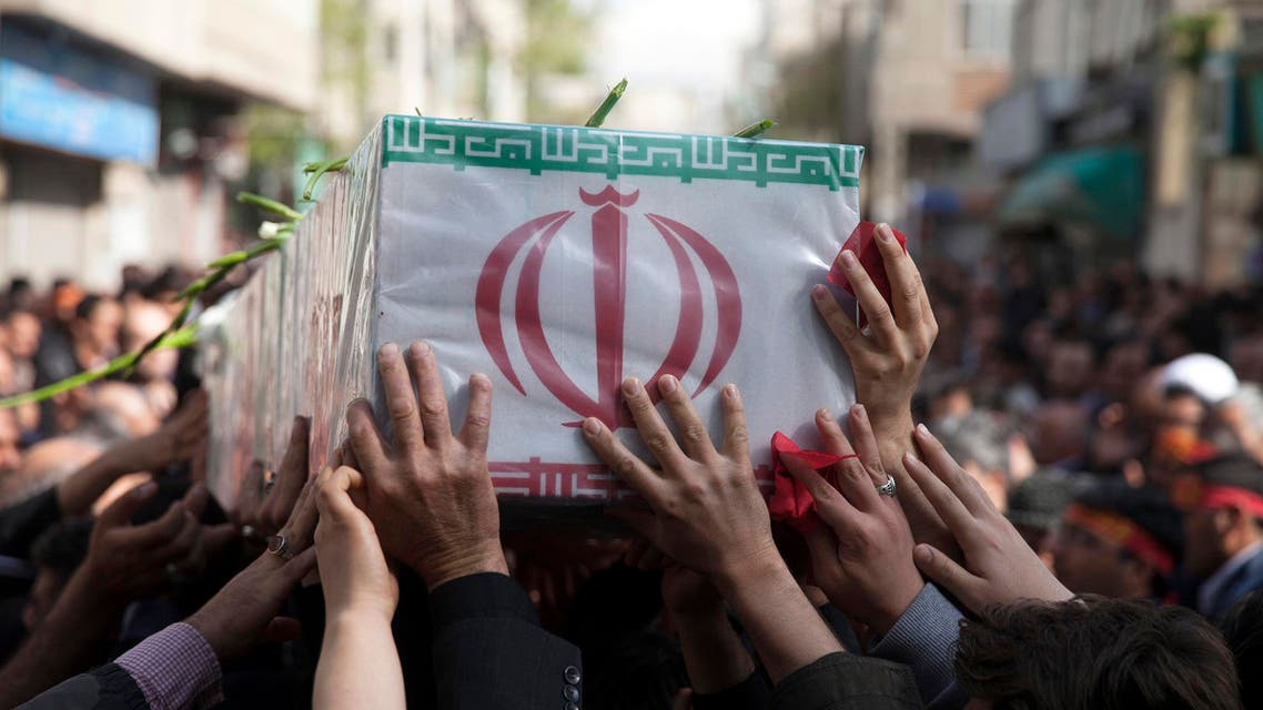 In this picture taken on Sunday, March 29, 2015, and released by the semi official Iranian Fars News Agency, a group of mourners carry the flag draped coffin of Ali Yazdani, a member of Iran's Revolutionary Guard, whom the Guard says has been killed during U.S. drone strike near the Iraqi city of Tikrit. AP