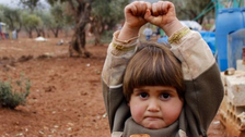 Photo of Syrian girl's 'surrender' to cameraman goes viral
