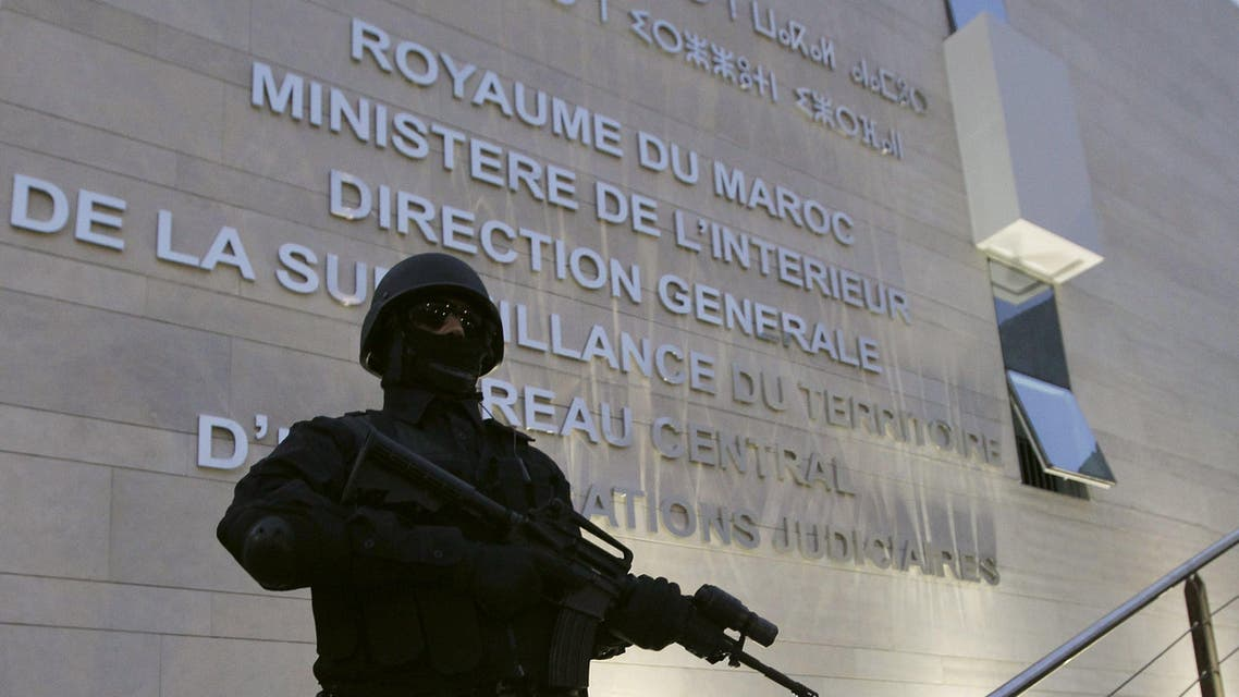 A Moroccan policeman stands guard at the Central Bureau of Judicial Investigation office in Sale, March 23, 2015. Reuters
