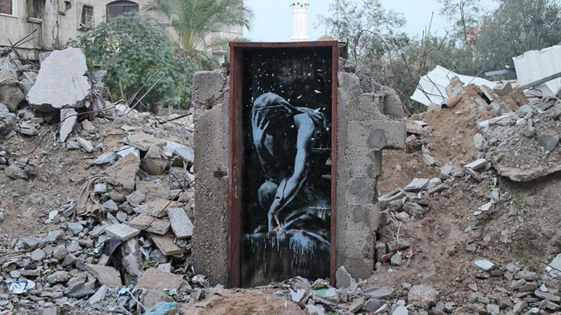 Mural depicting the Greek goddess Niobe, drawn on a door, the last remnant of a two-story house belonging to the Dardouna family in northern Gaza. (Twitter)
