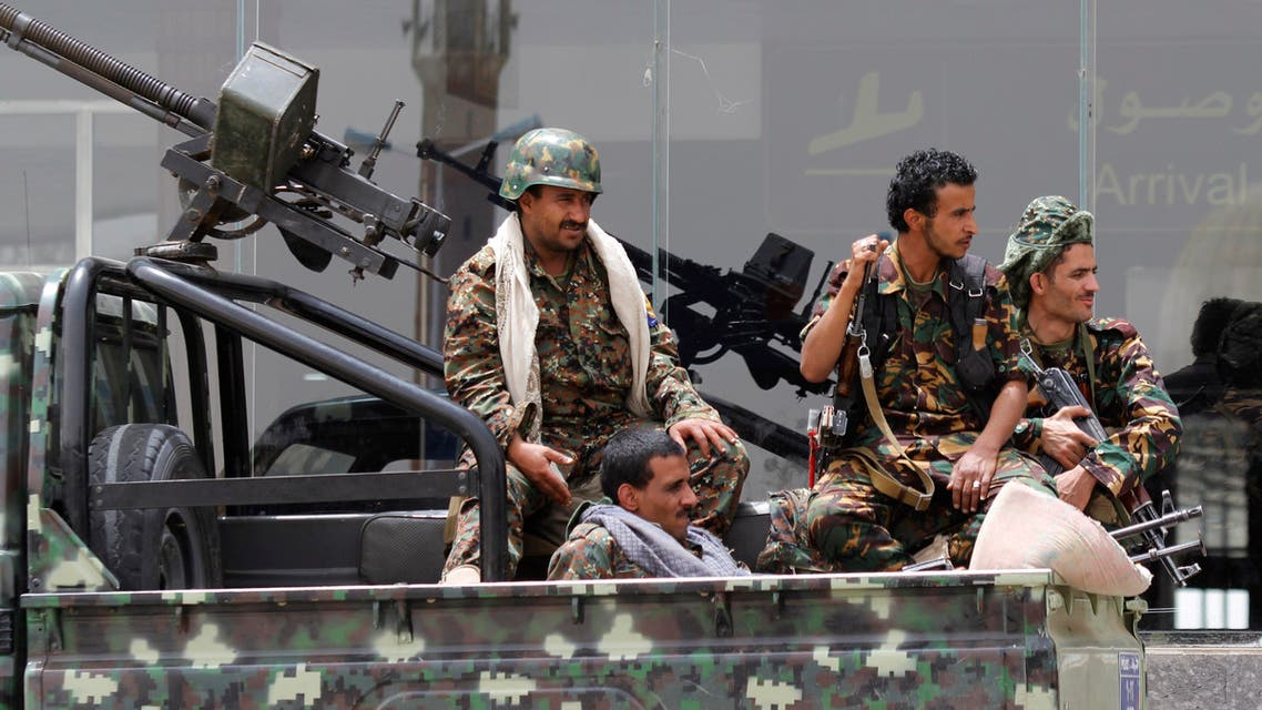 Shiite rebels, known as Houthis, wearing an army uniform, ride on an armed truck to patrol the international airport in Sanaa, Yemen, Saturday, March 28, 2015. AP