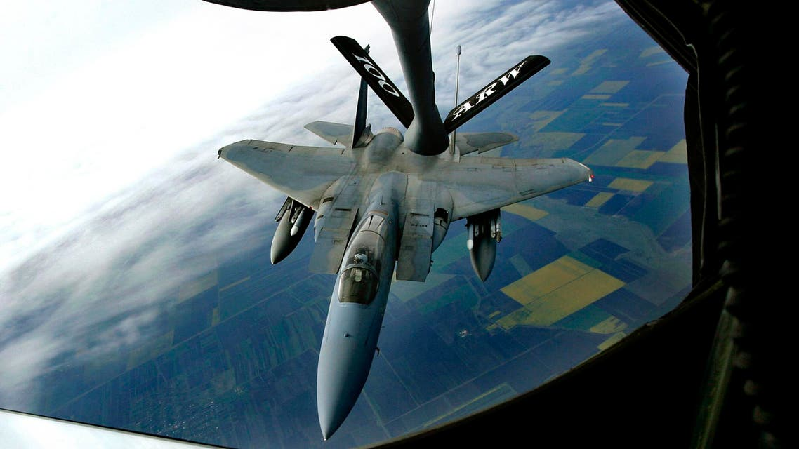 In this May 2, 2007, file photo, a U.S. Air Force F-15 fighter jet approaches a KC135 Stratotanker. (AP)