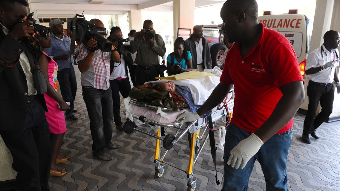 Medics help an injured person at Kenyatta National Hospital in Nairobi, Kenya, after being airlifted from Garissa after an attack by gunmen at Garissa University College. (AP)