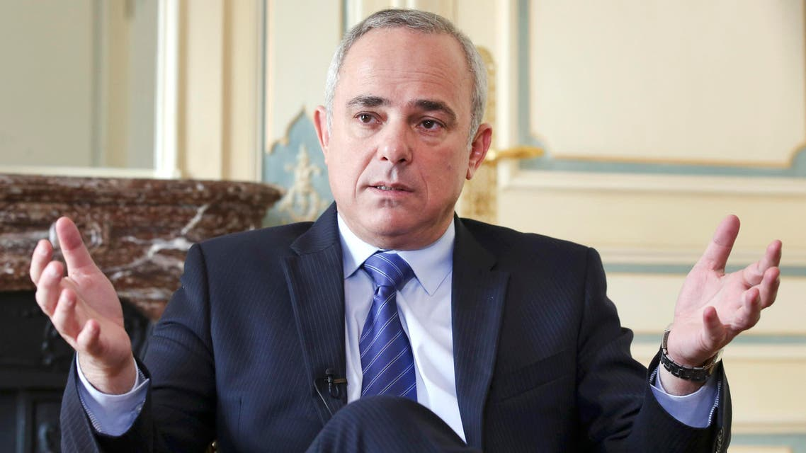 Israeli Intelligence Minister Yuval Steinitz gestures as he speaks during an interview with The Associated Press in Paris, Monday, March 23, 2015. (AP)