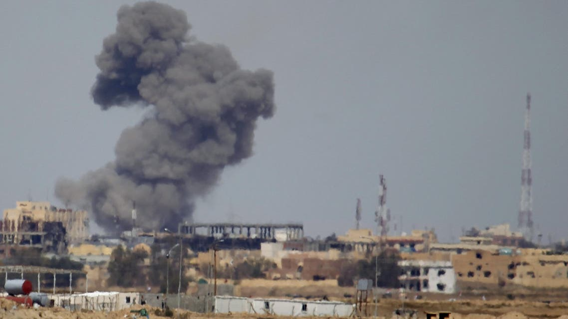 plume of smoke rises above a building during an air strike in Tikrit March 27, 2015. (File: Reuters)