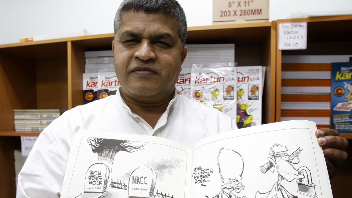 Malaysian cartoonist Zunar holds a copy of his comic book that has been banned by the Malaysian Home Ministry in Kuala Lumpur, Malaysia, Friday, June 25, 2010. (File Photo: AP)