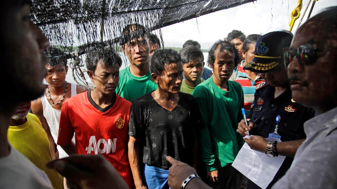 Indonesian officials question foreign fishermen during an inspection in Benjina, Aru Islands, Indonesia, Friday, April 3, 2015. (AP)