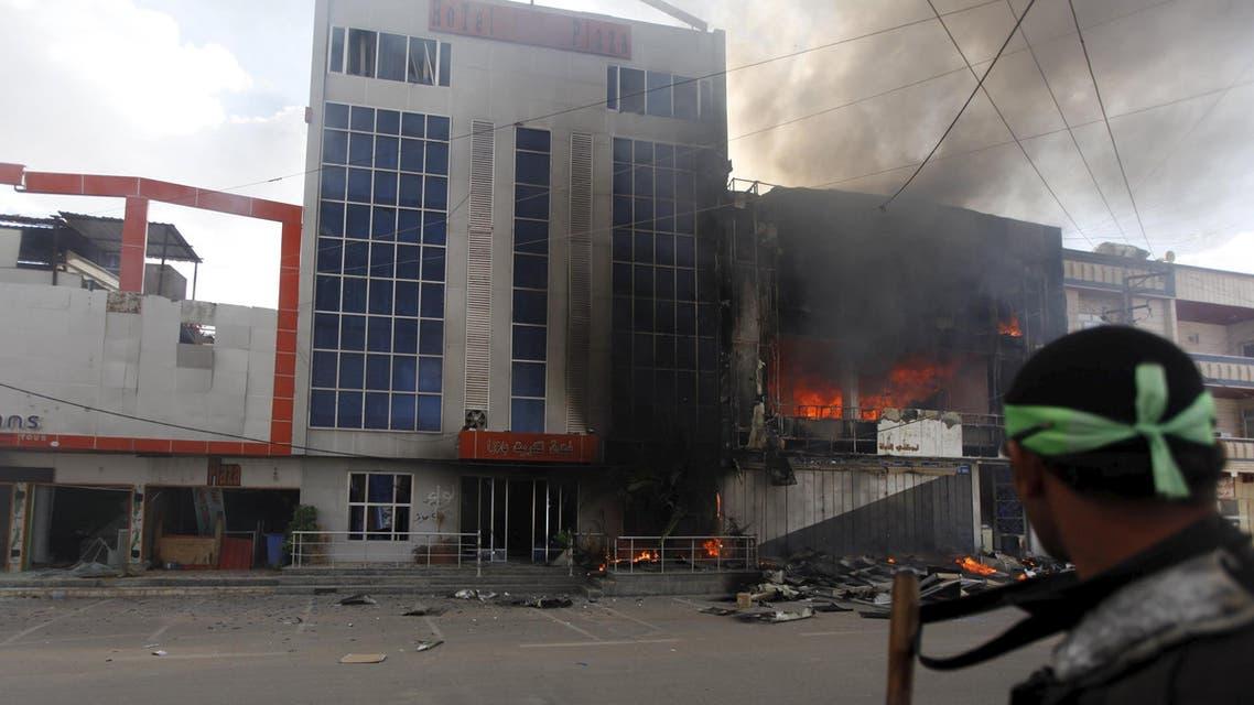 Smoke rises from burning shops in Tikrit April 2, 2015. (Reuters)