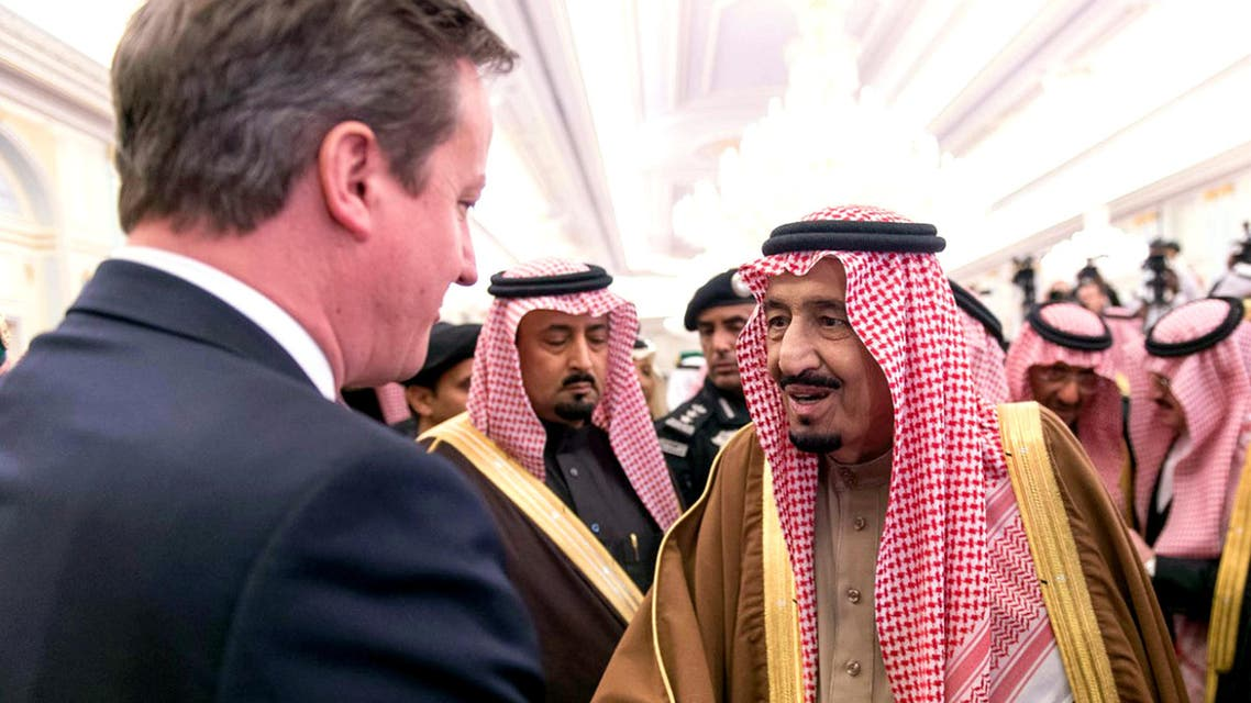 In this photo provided by the Saudi Press Agency, newly enthroned Saudi King Salman, right, greets the Prime Minister of the United Kingdom, David Cameron, left, in the king's dewaniya, a traditional Arab reception area to receive guests, where Cameron offers condolences for late King Abdullah, in Riyadh, Saudi Arabia, late Saturday, Jan. 24, 2015