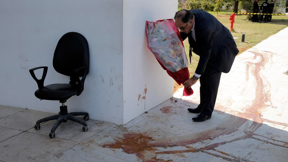 An MP lays flowers next to a a blood stain at the Bardo museum in Tunis, Tunisia, Thursday, March 19, 2015, a day after gunmen opened fire killing over 20 people, mainly tourists. (File Photo:AP)
