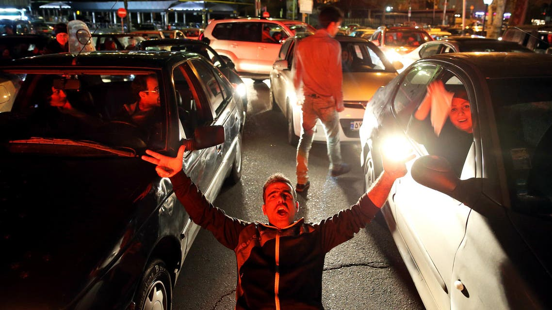 Iranians celebrate on a street in northern Tehran, Iran, Friday, April 3, 2015, after Iran's nuclear agreement with world powers in Lausanne, Switzerland. (AP)