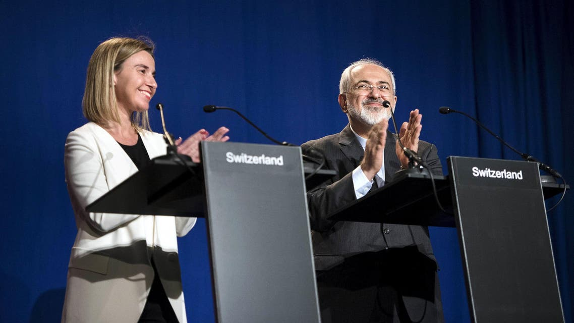 European Union High Representative for Foreign Affairs and Security Policy Federica Mogherini (L) and Iranian Foreign Minister Javad Zarifat clap after making statements following nuclear talks at the Swiss Federal Institute of Technology in Lausanne (Ecole Polytechnique Federale De Lausanne) April 2, 2015. Reuters